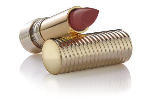 Marsala red color lipstick sample in luxury open golden tube on a golden lid, reflected on the surface, isolated on white background, clipping path included